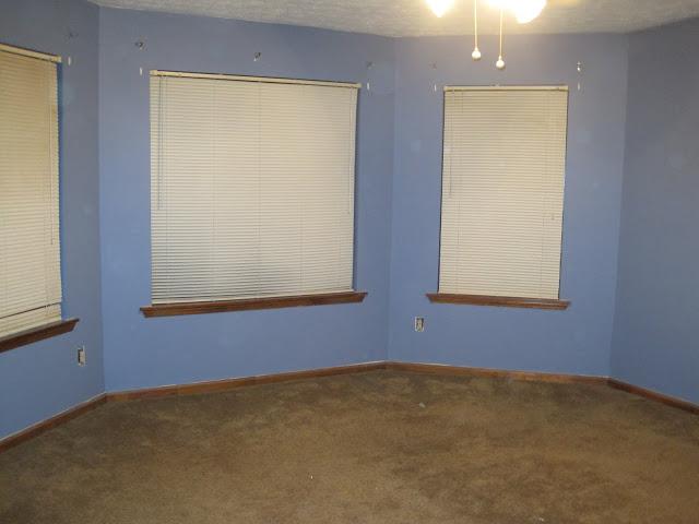master bedroom original blue walls and brown carpet