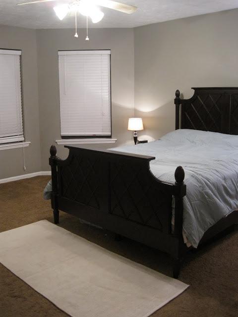 master bedroom with gray walls and dark queen bed