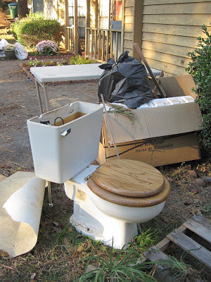 powder room remove toilet on front lawn