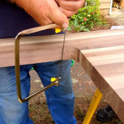 cutting a sink hole in butcher block - we had to fix the curve of the cut after a jigsaw error