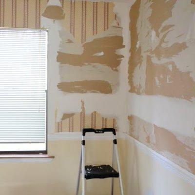 peeled and torn drywall after stubborn wallpaper removal in the dining room