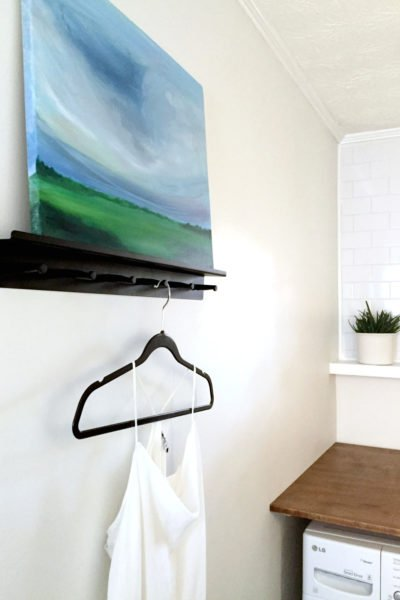 laundry room with painting and hanging space