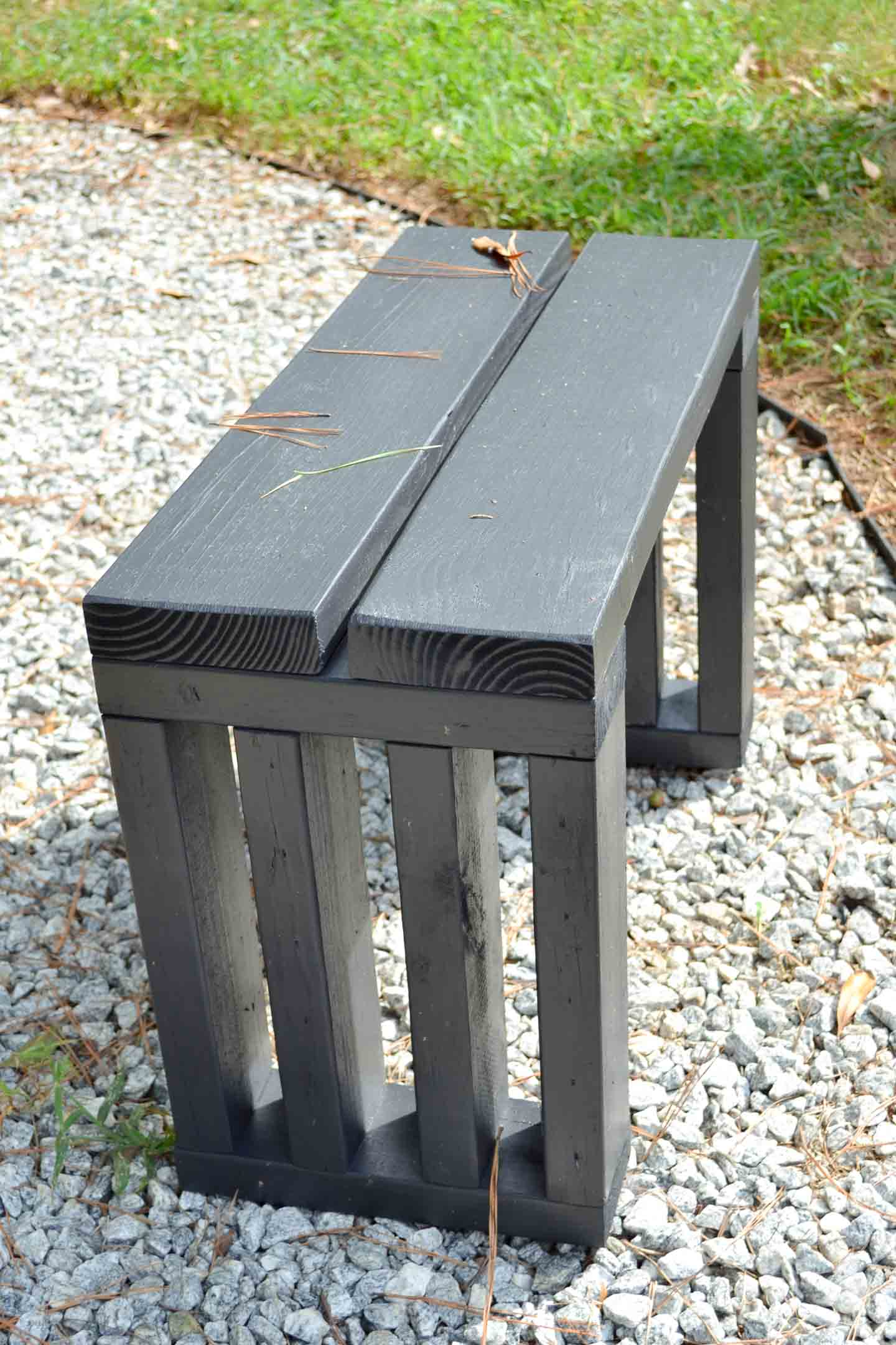 scrap wood garden bench seat with new black paint