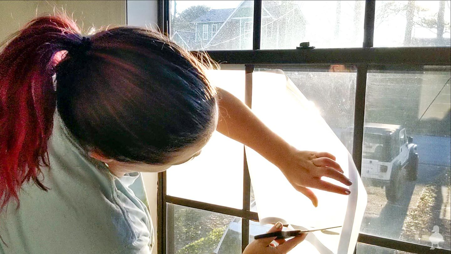roll out window film and cut to approximate size