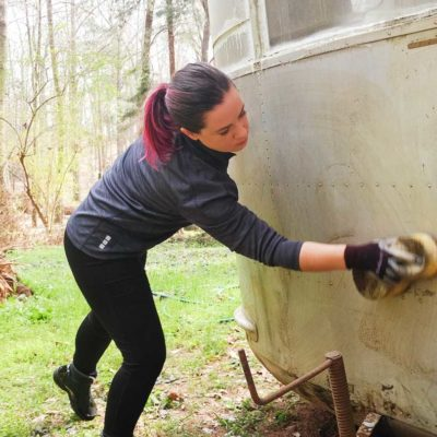 washing the front of the travel trailer (Ruby's Revival)