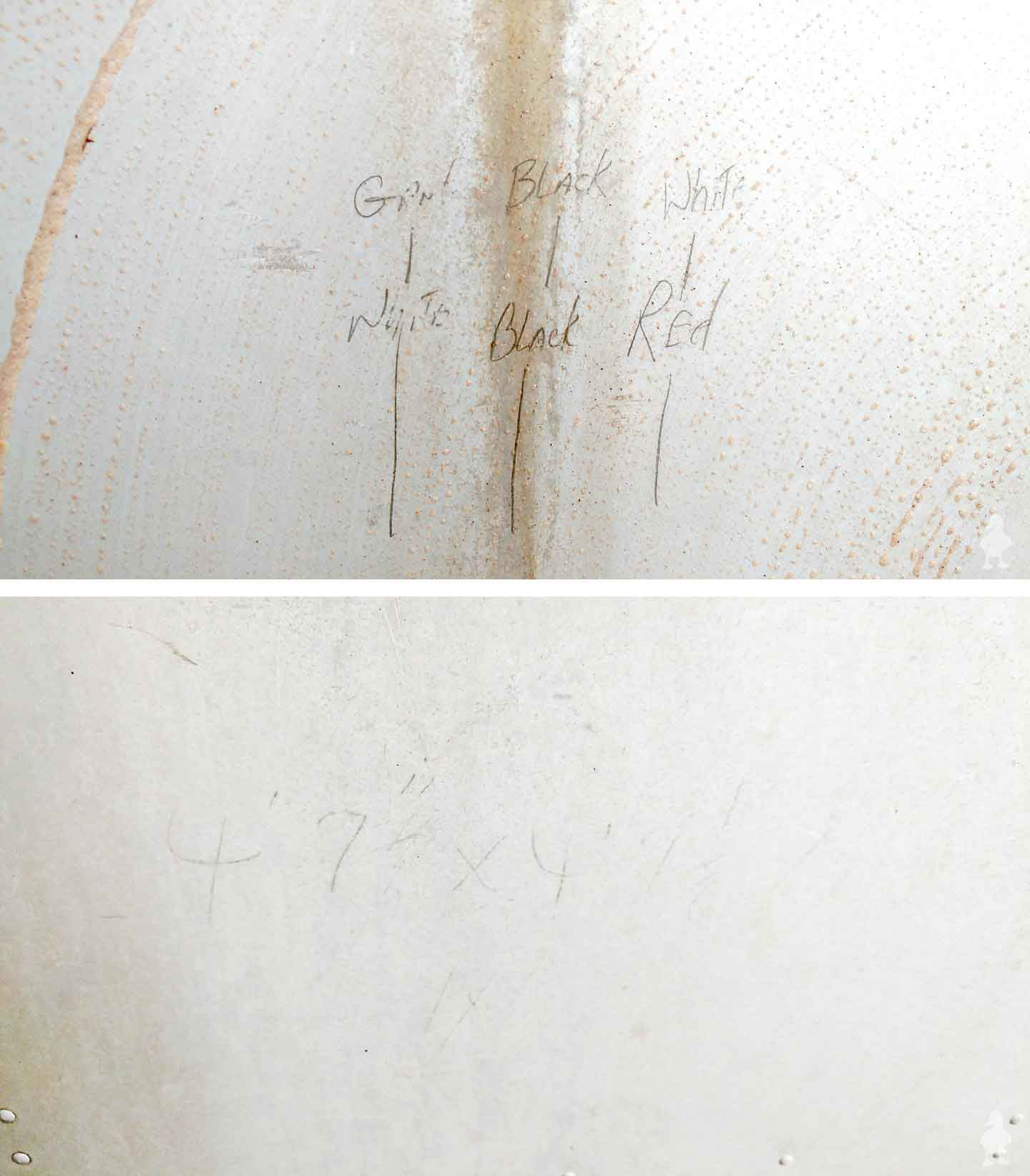 closeups of handwritten measurements on exterior of vintage camper trailer