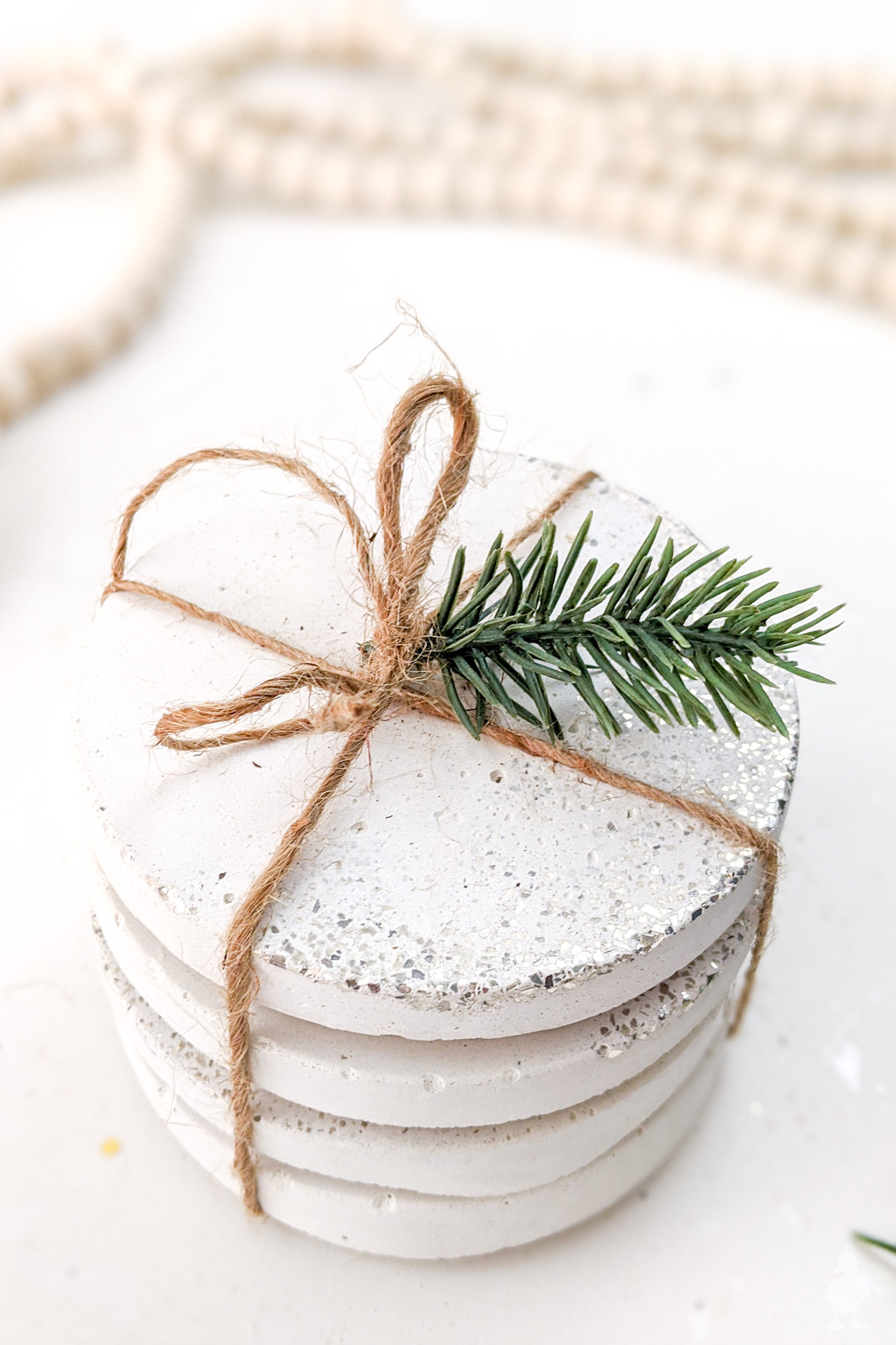 wrap coasters with twine to give as a gift #whiteconcrete #diycoasters #glitter #confetti #newyears #partydecoration #hostessgift #neighborgift