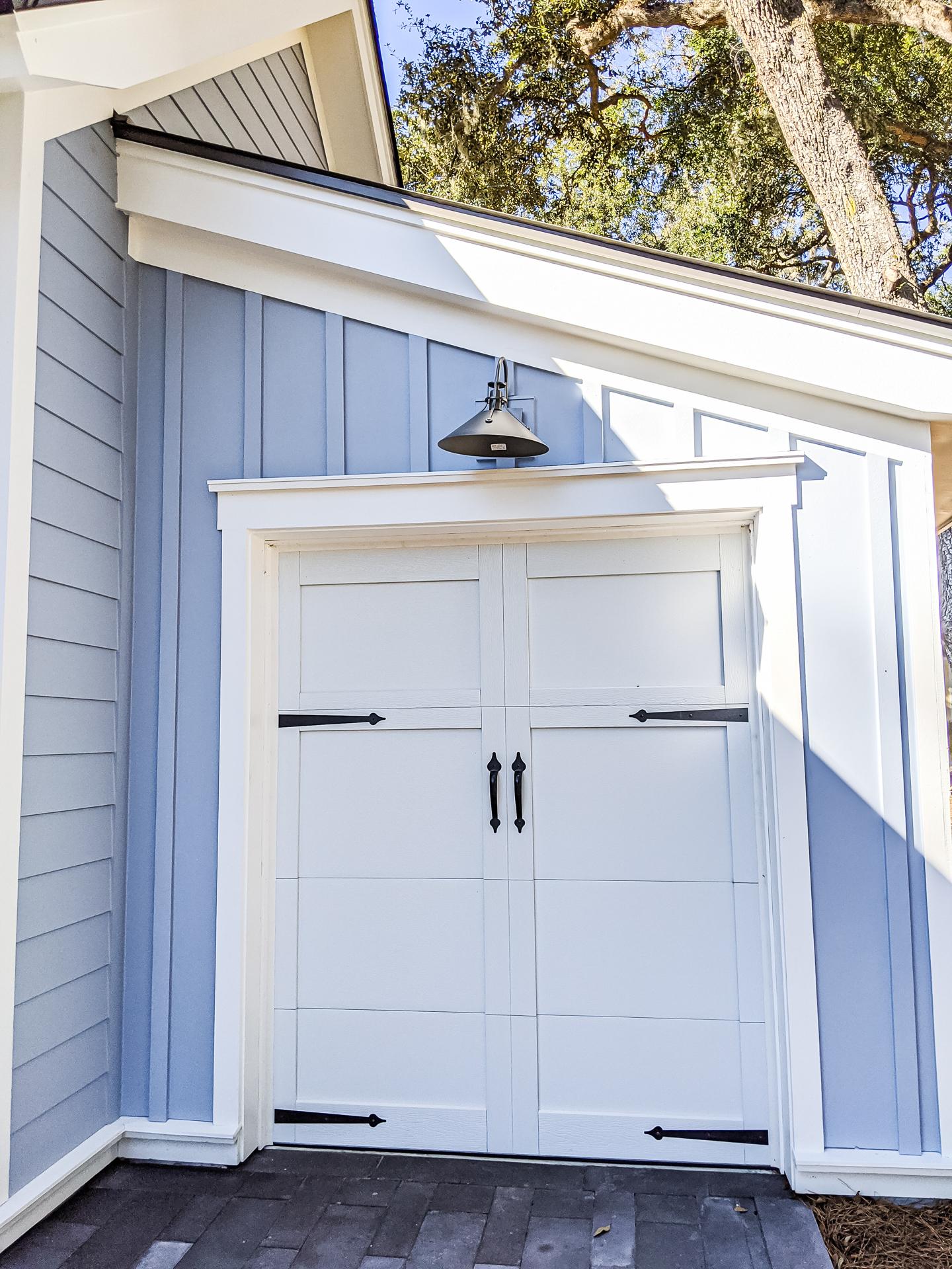 Garage door blue siding white trim