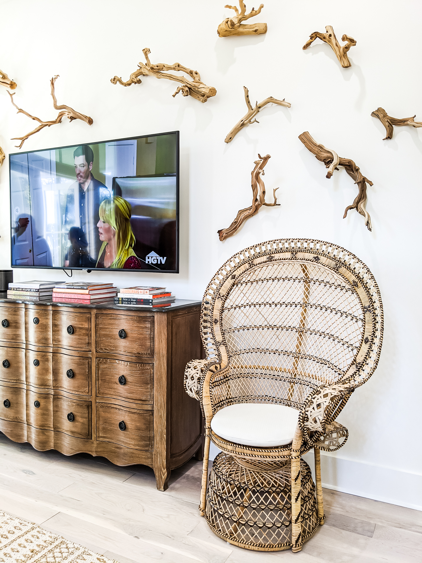 driftwood accent wall installation art - wicker chairs
