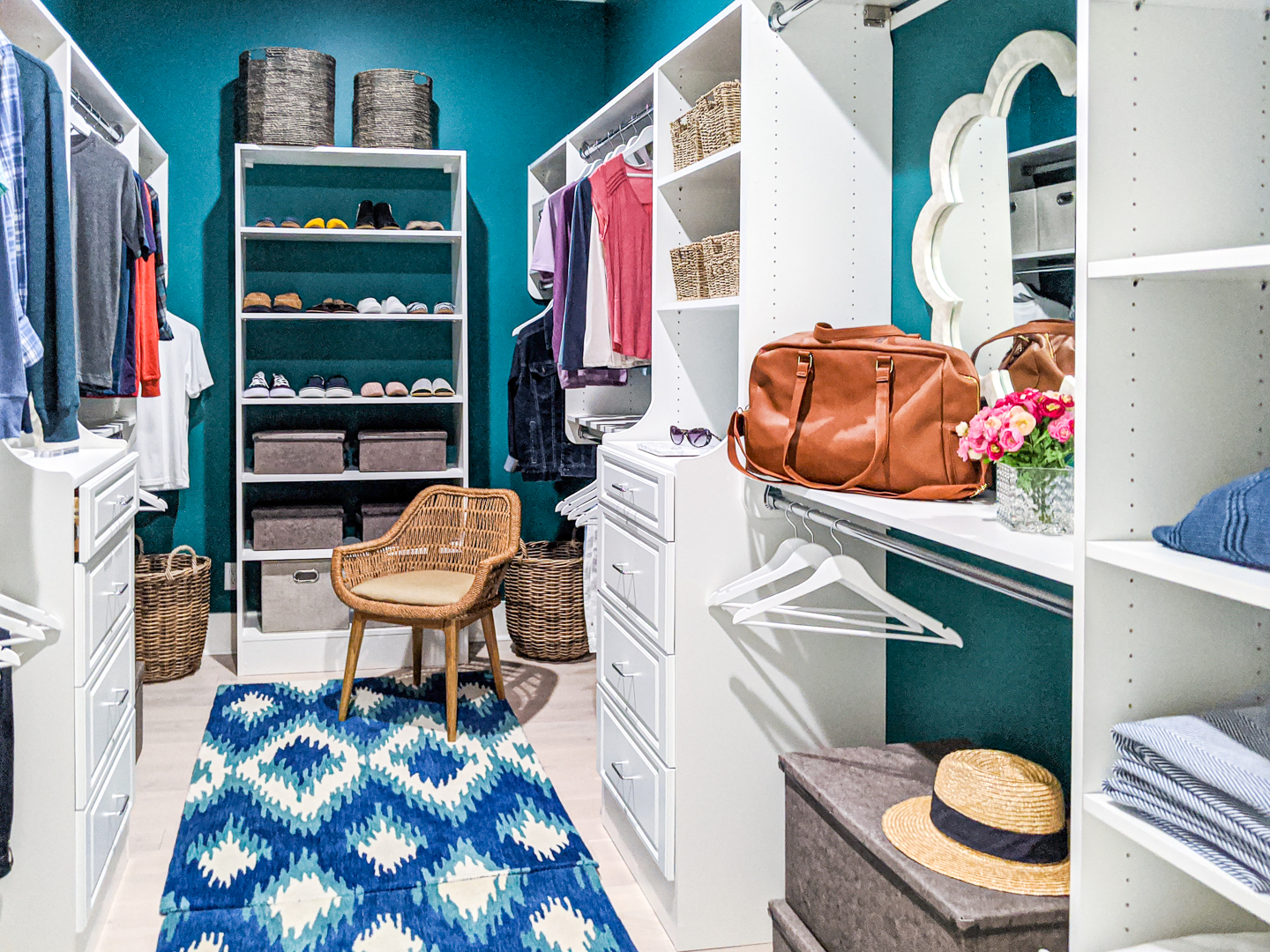 teal closet with white accents blue ikat rug