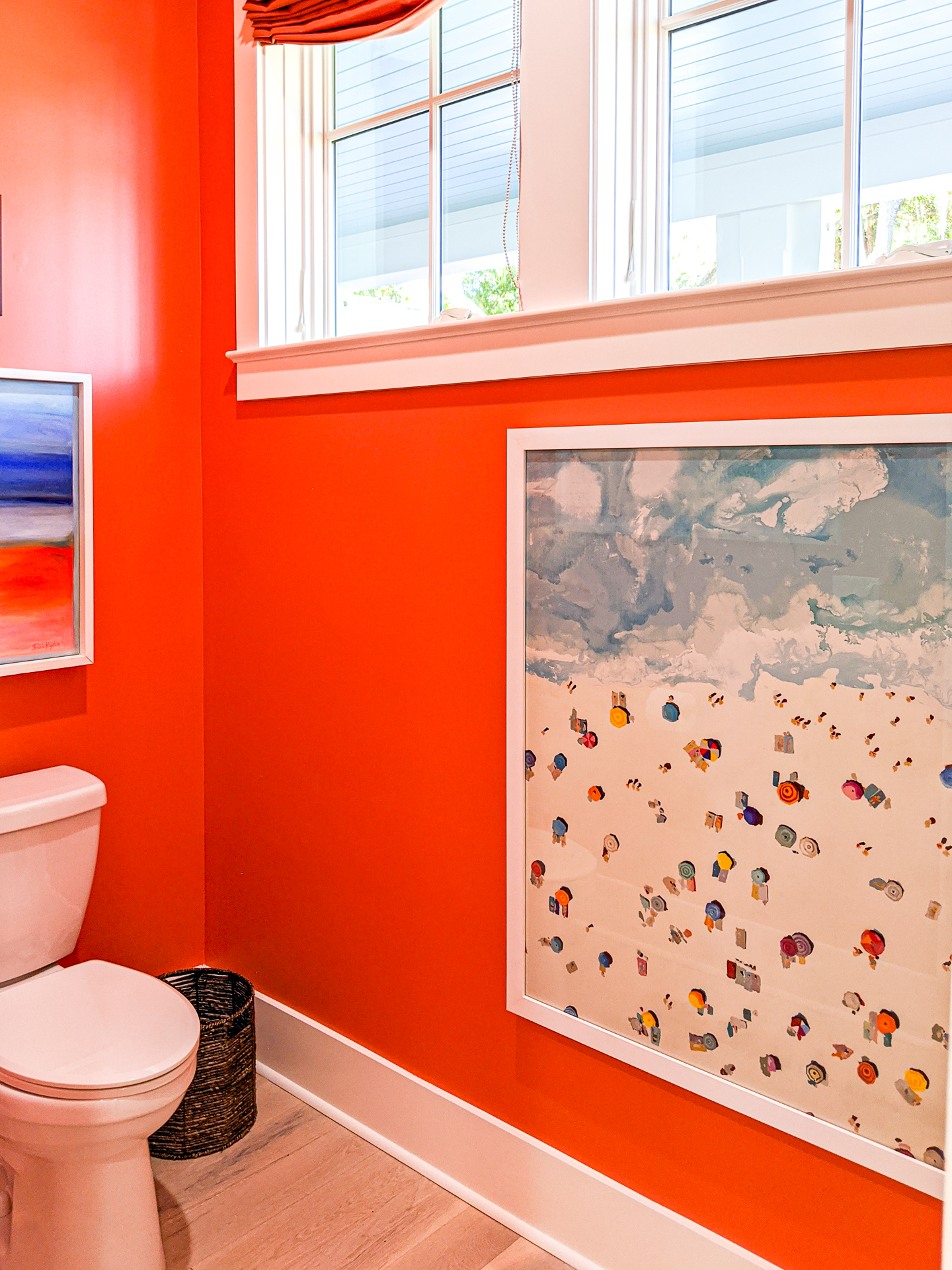 coral bathroom with large wall art