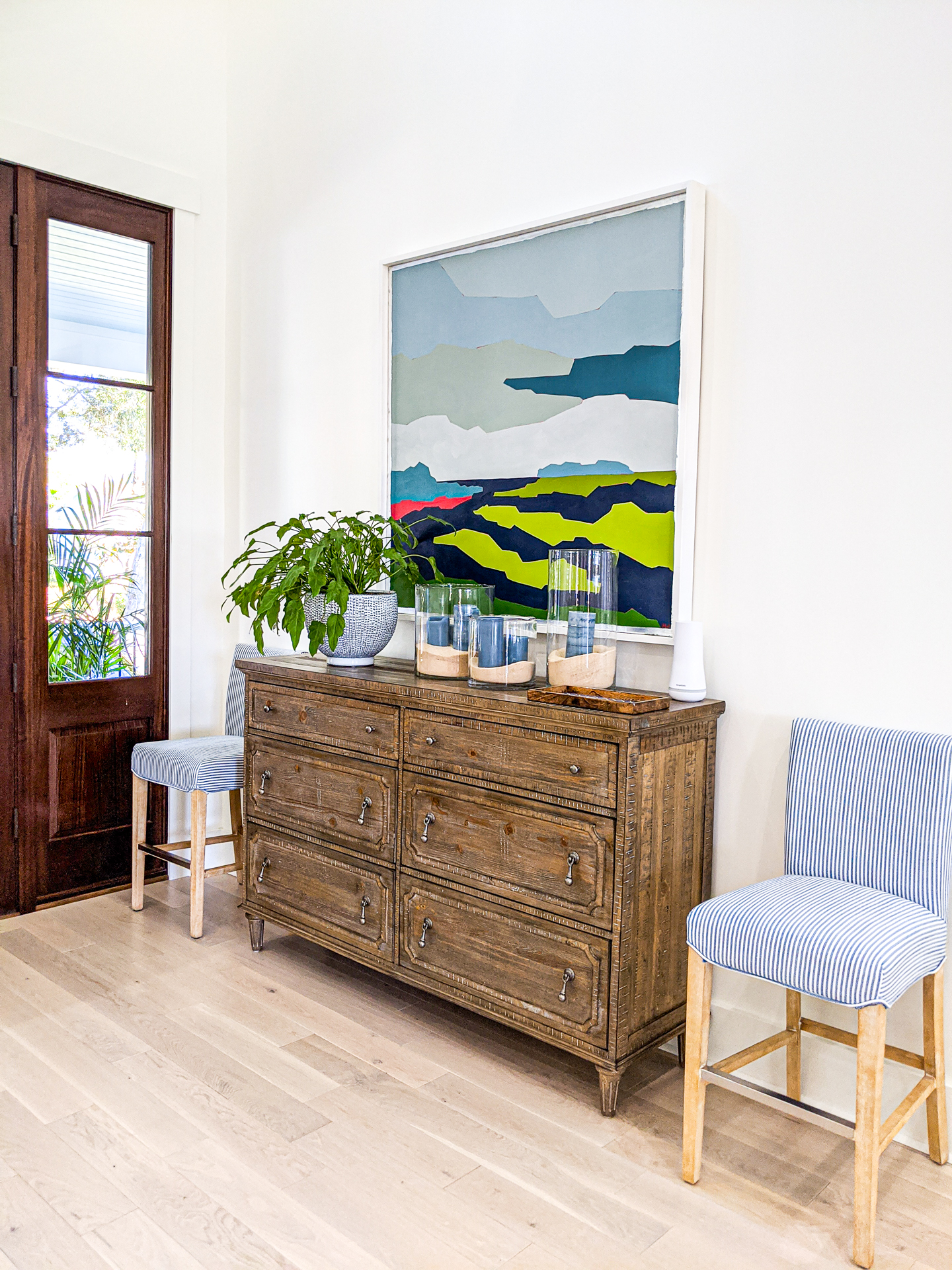 white walls entryway with stained wood door