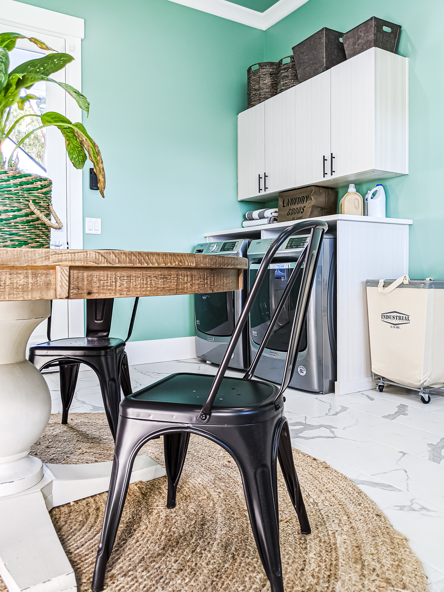 center table in mudroom laundry room black metal chairs