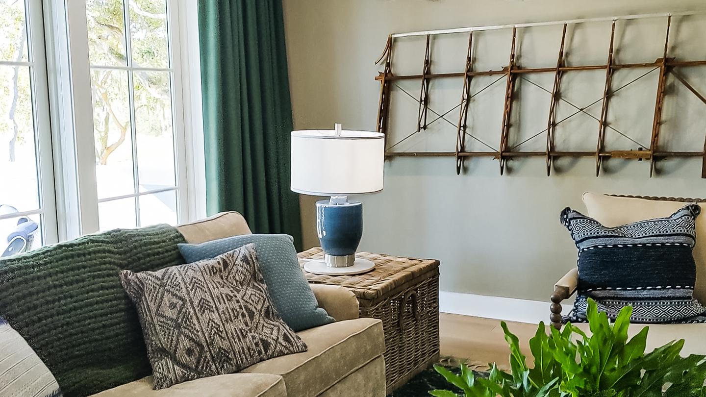 mutipurpose family room beige walls unique art HGTV dream home