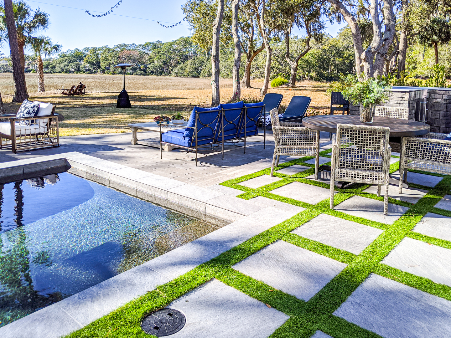 square concrete blocks with grass in between back yard