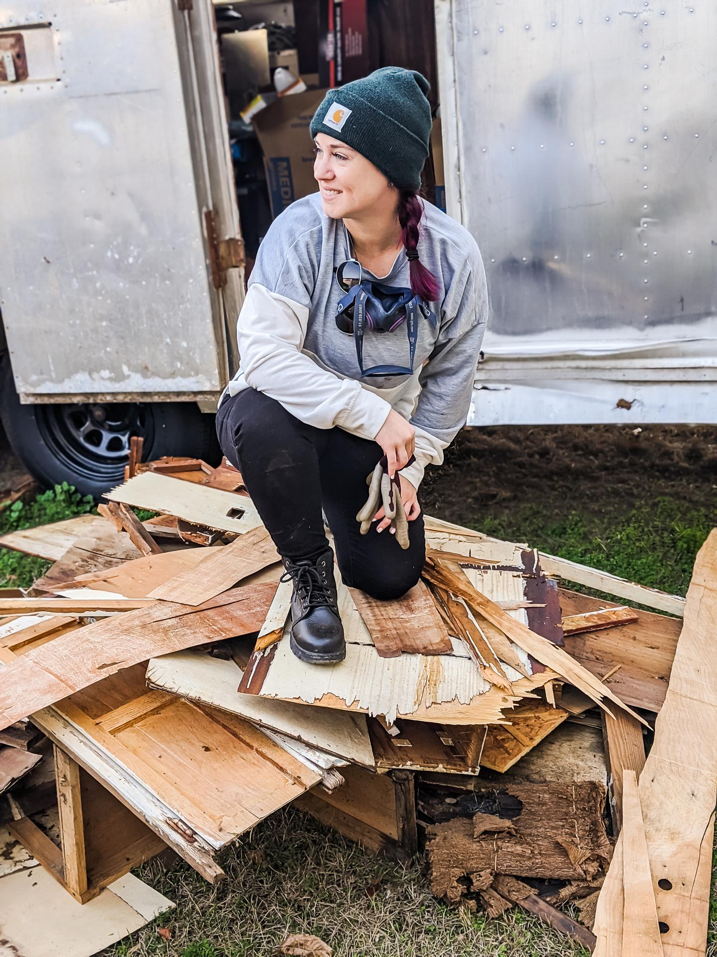 Sarah Fogle - kneeling on demo pile for Ruby's Revival