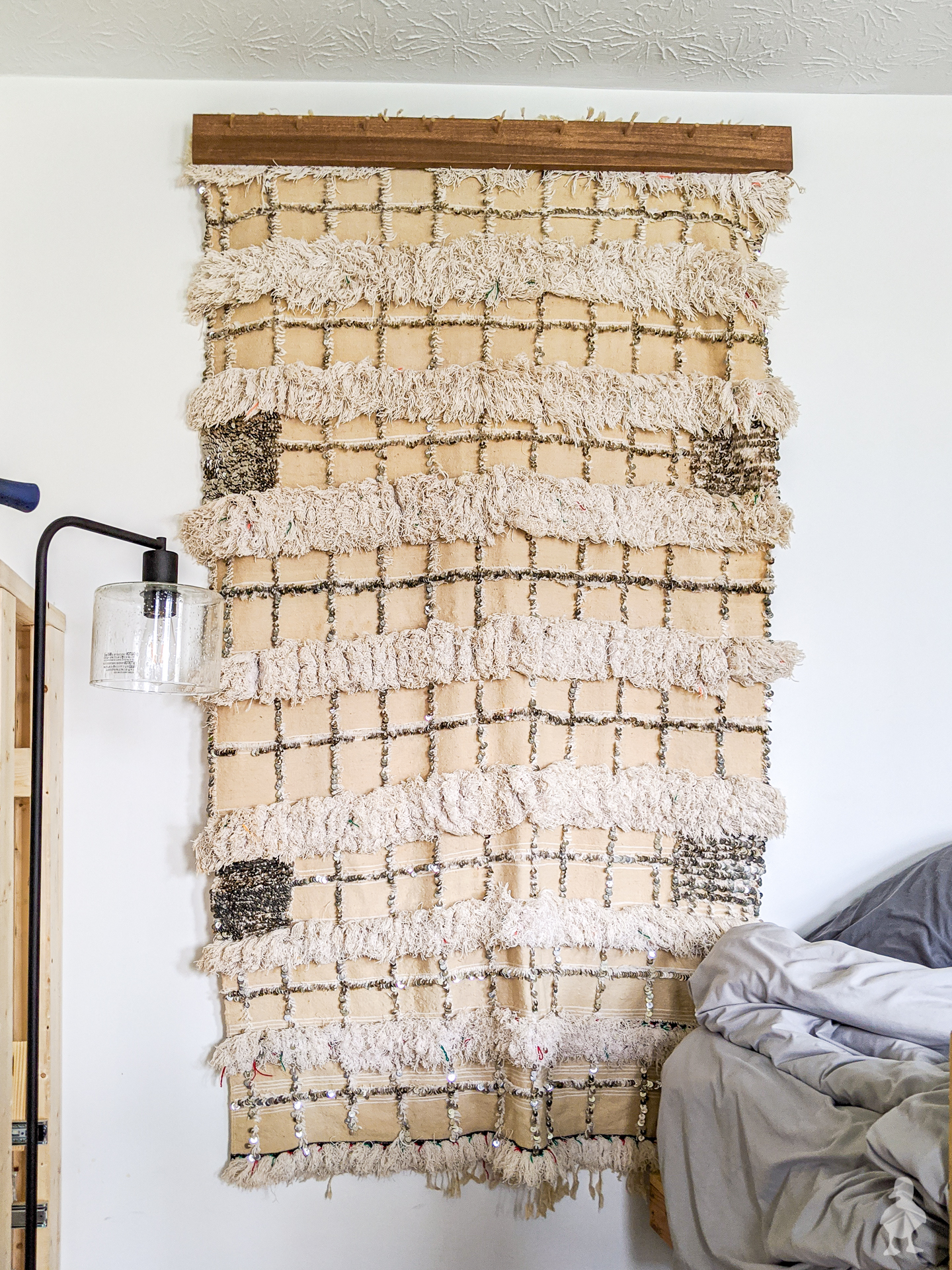 moroccan wedding quilt as wall hanging