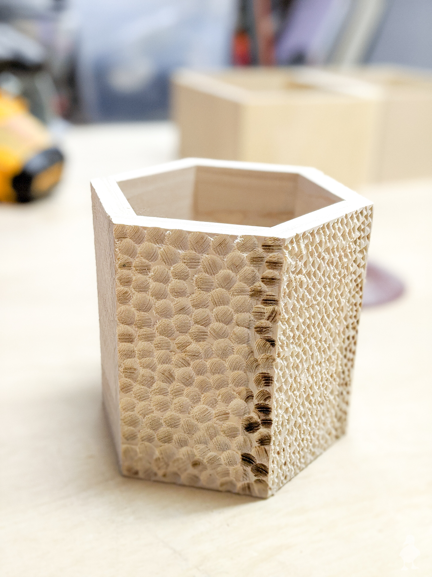 hex planters with carved texture on each side from dremel or die grinder