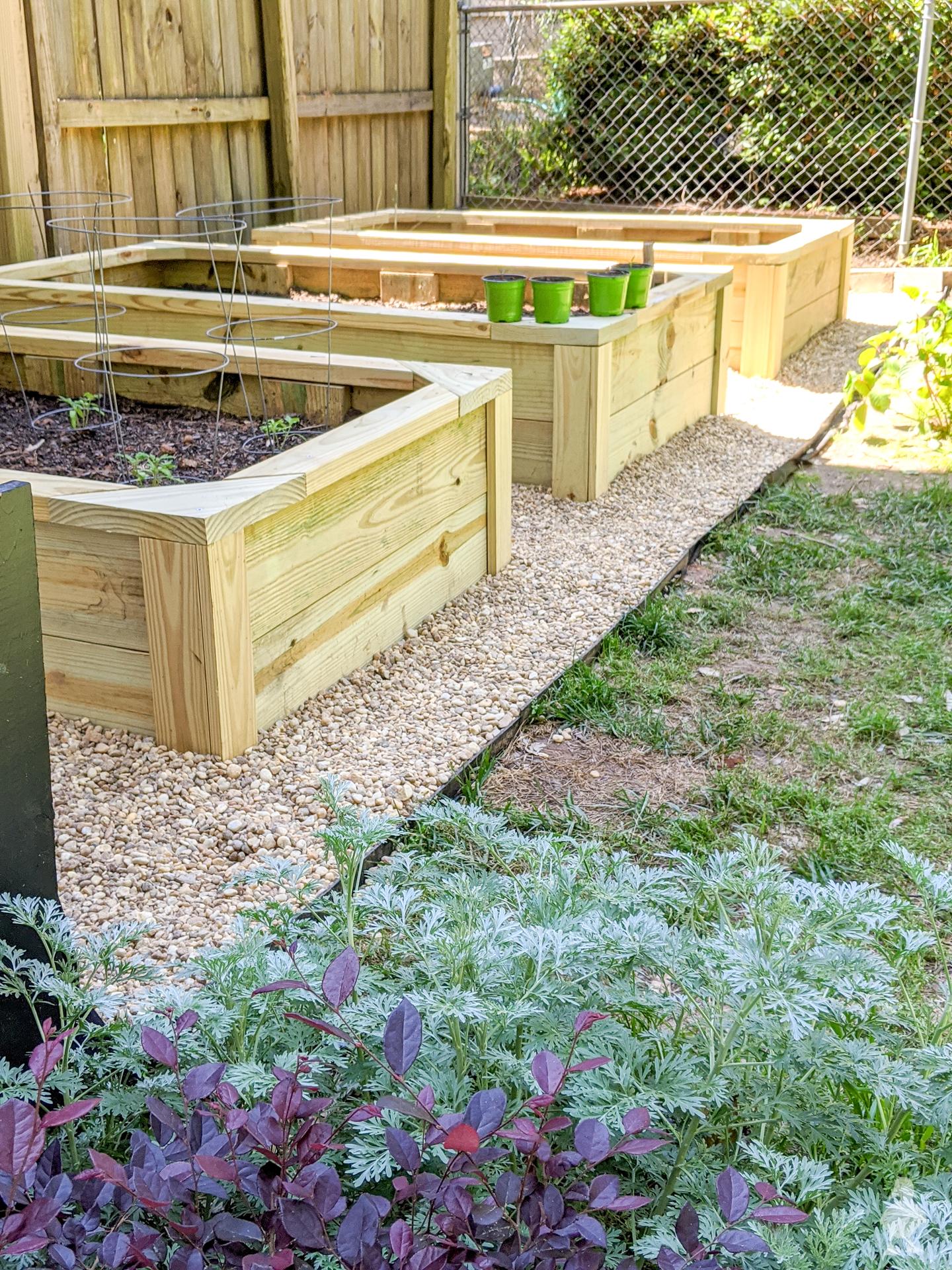 new garden beds in corner of back yard