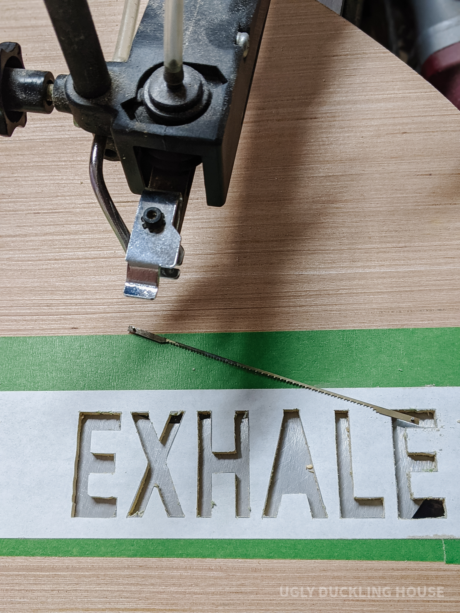 """cut out the word """"exhale"""" using a scroll saw"""