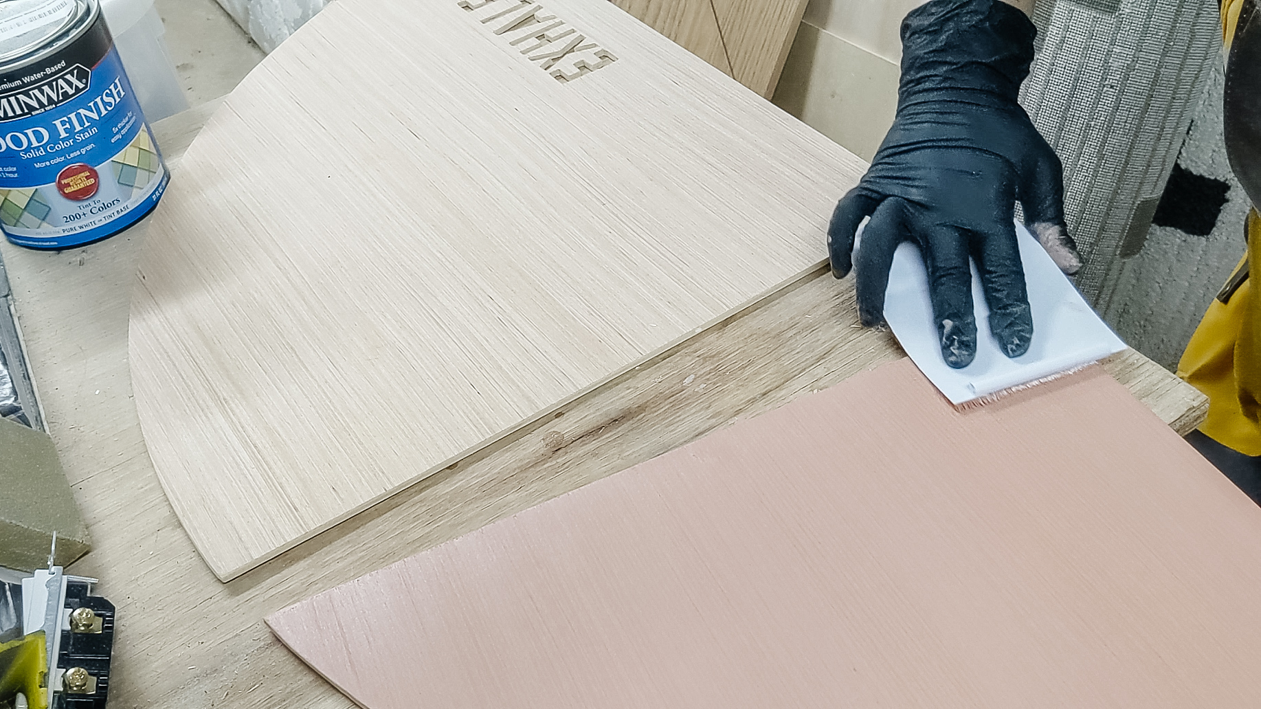 apply soild color stain to the surface and wipe off in minutes